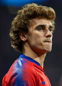 Antoine Griezmann of Atletico de Madrid looks on prior to the UEFA. Antoine Griezmann, Medium Hair Styles, Long Hair Styles, Sports Images, Sport Football, Uefa Champions League, That Look, Hairstyle, Guys