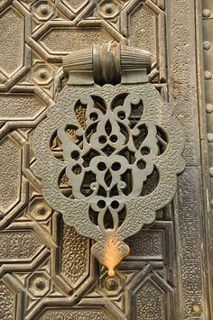 Door handle of Seville Cathedral Seville, Spain. http://www.costatropicalevents.com/en/costa-tropical-events/andalusia/cities/seville.html
