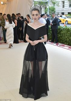 Asymetric: Lily wore an asymetrical midnight black top with an ivory border, with its cut ...