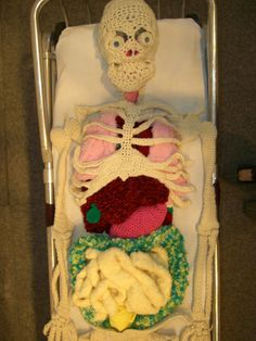"Artist Shanell Papp has a project called ""Bawdy,"" which is about bodies and textiles. The centerpiece is ""Lab,"" a yarn skeleton with a complete set of organs. Lab (skeleton) (via Making Light) Crochet Art, Cute Crochet, Crochet Crafts, Crochet Toys, Crochet Projects, Crochet Patterns, Crochet Animals, Crochet Things, Yarn Projects"