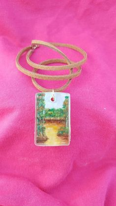 Resin pendant with hand-drawn watercolor landscape with brown suede cord. World Crafts, Resin Pendant, Watercolor Landscape, How To Draw Hands, Unique Jewelry, Handmade Gifts, Chain, Christmas Ornaments, Holiday Decor