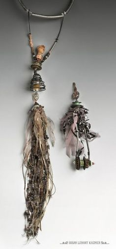 susan lenart kazmer- figurative and wearable. Her outfit can be switched out with the unicycle piece to the right. An uncycled lock is hidden under forged wire. The key can be switched out.