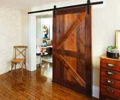 Check out this amazing sliding barn door Tom Silva built from original floorboards that he salvaged from the Arlington Project House attic! | Photo: Anthony Tieuli | thisoldhouse.com