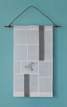 Very simple: Two bars of color and a print or embroidery in one piece.