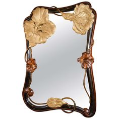 Rare and Outstanding Art Nouveau Mirror in Hand Carved Mahogany   From a unique collection of antique and modern wall mirrors at http://www.1stdibs.com/furniture/mirrors/wall-mirrors/
