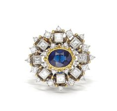 A sapphire and diamond ring, Buccellati  centering an oval-shaped sapphire within an openwork surround detailed with square and round brilliant-cut diamonds; signed Buccellati; sapphire weighing approximately: 1.60 carats; estimated total diamond weight: 1.00 carat; mounted in eighteen karat bicolor gold