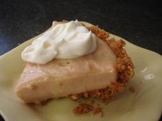EASY PEANUT BUTTER PIE  1 c. powdered sugar   1/2 c. milk  8 oz. Philadelphia cream cheese  1/2 c. peanut butter  8 oz. Cool Whip  Graham cracker crust.Directions: Dissolve powdered sugar in milk, add softened cream cheese and peanut butter.Beat until smooth. Add Cool Whip. (Reserve some for topping.) Pour into ready  made graham cracker crust. Chill. Ready to serve in one hour. Add topping or graham cracker crumbs.