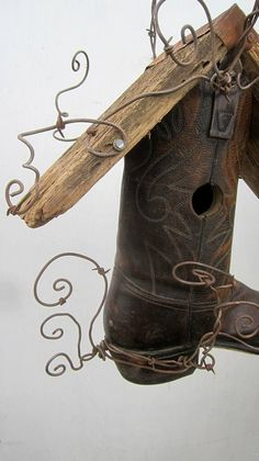 "** Wire Wrapped ""Montana Cowboy Boot Birdhouse With Barbed Wire"" @thedustyraven"