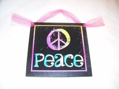 """Pink Aqua Black Peace Sign Wooden Wall Art Teen Girls Bedroom Decor by The Little Store Of Home Decor. $7.99. size 7x7. Made of Wood. Handmade in the USA. We've sealed this very fun and adorable Peace print onto wood giving it a framed appearance. The background color is black and it measures approximately 7"""" squared by 1/4"""" thick (wood dimensions not including hanger). We've added a hot pink ribbon for easy hanging and added charm"""