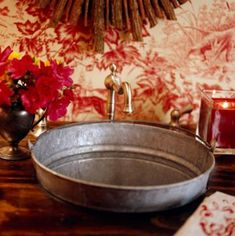 What a clever idea! Use a galvanized pail (with the handle still in tact!) instead of a standard sink basin. | 12 country-style washrooms | Living the Country Life | http://www.livingthecountrylife.com/homes-acreages/country-homes/12-country-style-washrooms/