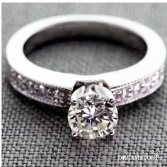 1.11 Carat, H Color, VS2 Clarity, Very Good Cut, Round Diamond in a 18K white gold milgrain pave set diamond engagement ring