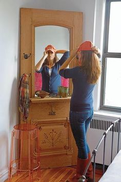 recycle a old door to a hallway mirror... I need to do this... I also need to find a place in my house to put it!