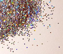 Glitter: It is not to be confused with confetti, which contains larger pieces, and should also not be confused with sequins, which are larger yet.