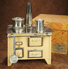 """French Tin and Chrome Toy Stove by JEP~~~9"""" (23 cm.) The tin toy stove with pale cream finish and chrome surface, towel bar, and trim has original chimney and pots and pans. The stove is preserved in its original box labeled JEP, Unis France. Excellent condition. French, Jep, circa 1940s."""