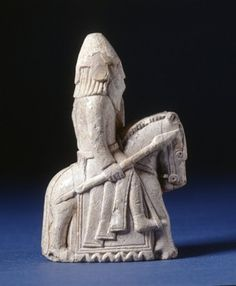 Chess-piece; walrus ivory; knight on horseback; conical helmet; spear and kite shield decorated with incised lozenge.