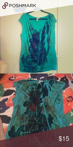 """Size 2x pleated top Comfortable pleated top in 2xl. Pretty floral print on front and back. Front of top has pretty rhinestones on part of the flower. Shirt is like new. Measures approx. 23"""" across from armpit to armpit & approx 27"""" long from top to bottom hemline. 95% polyester, 5% spandex. L8ter Tops Tees - Short Sleeve"""