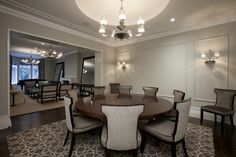 contemporary dining room with round wooden table