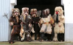 """""""People taking part in the Carantonas festival in Acehuche near Caceres in the southwestern Estremadura province. Mixing paganism and Christianity the monster-animal like 'Carantonas', a patchwork of sheep, cow, rabbit and goatskins under painted masks, search for Saint Sebastian in the streets of the village eventually congregating at the village church, for a procession with the statue of the patron saint."""""""