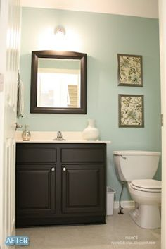 Downstairs bathroom - Aqua - This is the exact color we have picked out. And I am thinking either tan accent colors, or dark brown accent colors. I haven't decided yet. The cabinets we have are maple, but they may not fit, so if they dont, we are going with the dark wood and dark brown accent colors!.
