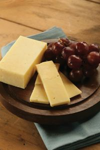 Our Tipperary Cheddar comes from the land of Tipperary in Ireland.  This part of Ireland is known for its dairy products due to the green pastures and mild climate.  As a result, this great cheese exists.  It is aged over 12 months, and has a slightly crumbly texture and a wonderful sharpness to it.
