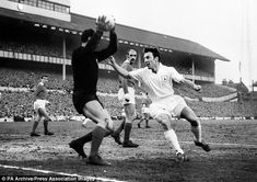 Benfica goalkeeper Costa Pereira beats Tottenham striker Jimmy Greaves to the ball in the 1962 European Cup semi-final at White Hart Lane