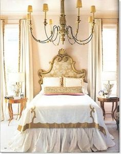 Antique Styled Bedroom in Peach, Gold, and Tan.  Stunning Headboard and Chandy.