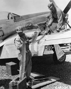 Ground crew reload a 78th Fighter Squadron P-51 on Iwo Jima
