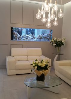The Lounge at K Dental Studios (116 Great Portland Street) www.kdentalstudios.co.uk #fishtank #dental #reception
