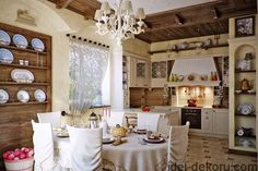 spacious kitchen with tiled floor, old-fashioned black stove, round table covered with beige fabric, and six matching chairs, shabby sheek interior Sillas Shabby Chic, Cocina Shabby Chic, Shabby Chic Chairs, Shabby Chic Homes, Shabby Chic Furniture, Cottage Kitchen Backsplash, Kitchen Backsplash Images, Backsplash Ideas, Kitchen Cabinets