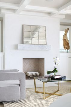 Fireplace features a Floating marble box mantle. The master bedroom fireplace features a floating marble box mantle. Winkle Custom Homes. Beach Fireplace, Stucco Fireplace, White Fireplace, Bedroom Fireplace, Fireplace Mantle, Fireplace Design, Fireplaces, Mantel Styling, Kirkland House