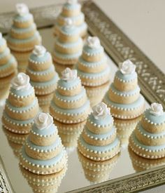 Little Sugar cookies stacked & decorated into mini wedding cakes... darling!!...SHOWER IDEA