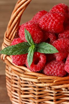 """Fresh raspberries."" by ZakariaSnow on Flickr - Fresh sweet raspberries with water drops in a wicker basket close-up"