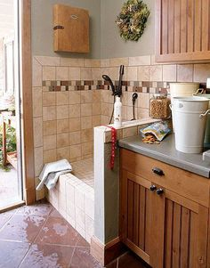 dog wash station combined with laundry room and mud room. Direct entry from the garage, so no dirty is trekked in. And a pocket door leading to the kitchen. Love it!! DogWashStation can be added to the mud room or laundry room