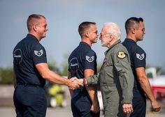 Former astronaut Buzz Aldrin flying in the diamond with the Thunderbirds.