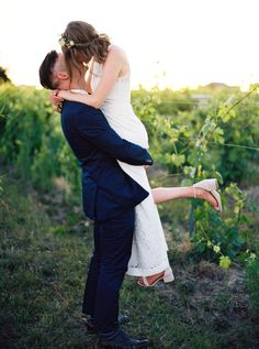 Bride and groom kissing at their rustic winery wedding: http://www.stylemepretty.com/2016/09/21/stylish-rustic-chic-winery-wedding/ Photography: Anna Peters - http://www.annapetersphoto.com/