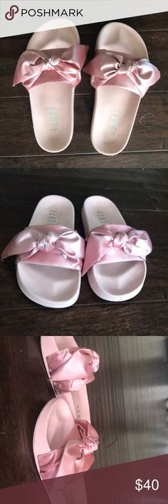 FENTY X PUMA Rihanna bow slides Good condition! Comes with box and shoe bag. Slightly dusty on the bottom of the silk bows but could probably be easily cleaned. Lots of wear left and no real damage Puma Shoes Sandals