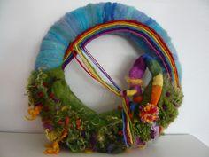Rainbow by seizoentafel Season Table needle felt creation. #Waldorf Needle felted #Rainbow Gnome swinging on rainbow with wool fleece garden. Divine