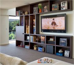 "built-in bookcase frames big-screen tv... and other ideas to design around a tv... general rule of thumb is that the distance from the television screen and your viewing spot should be between two to three times its width... example: with a 32"" screen, sit between 5½ and 8 feet (96"") away for the best entertainment experience"
