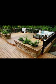 Stone detail on the built-in flowerbeds and multi-toned planking/rails add visual interest to this deck