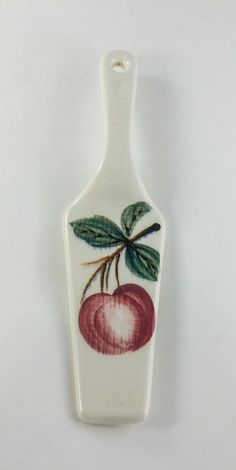 Great way to server cake or pie this summer with this peach theamed server.  White in color with a pink colored peach in the center with leaves.  9 1/2 inches long and 2 1/2 at the widest point.  No chips or cracks.