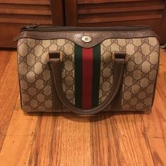 Vintage Gucci Monogram Speedy Satchel Small vintage Gucci monogram satchel in brown and green. Gently worn. Small scratches on leather strap. Very small black dot on leather strap. Green pen stains on the inside. Gucci Bags Satchels