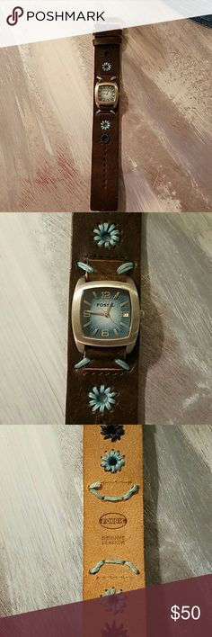 Fossil watch Brand new Fossil watch with a brown leather band with blue stitching, and pretty blue face. I have never worn. Fossil Other