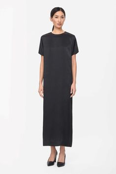 Made from smooth silk with a light-catching finish, this long dress is a simple straight shape. Short-sleeved, it has a split back, in-seam side pockets and a hidden zip and hook fastening on the back.