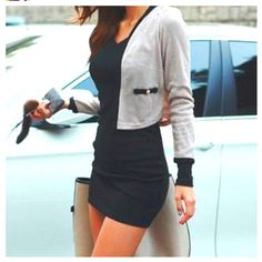 Love the shortness of this dress that is  balanced to be less revealing by covering up with a sweater.
