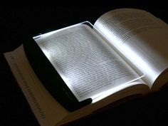 Perfect for hardcover and trade paperback books, the LightWedge LED Book Light has a revolutionary design with a leaf-sized acrylic lens that lays flat on the page. GetdatGadget.com/lightwedge-led-book-light-lights-page-room/