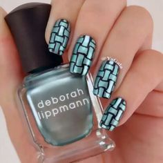 Shiny turquoise and black basket weave nail design art