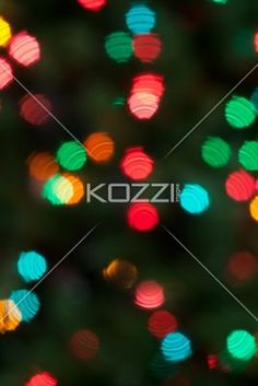shimmering lights in tree - Distorted multicoloured lights in a Christmas tree.
