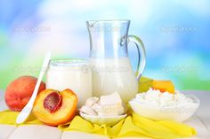 Fresh dairy products with peaches on wooden table on natural ... Loving Fresh Dairy product and the nutritional value you get from taking milk fresh from Uganda Farms