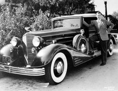 Robert Montgomery with his Cadillac Sport Phaeton