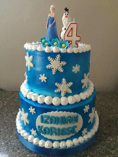 Our 2 tier themed Frozen cake made with boiled icing...